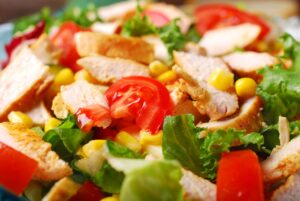 elle jay meal plan 300x201 - closeup on grilled chicken salad with cheese,vegetables and garlic sauce