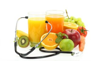 fruits fructose 300x200 - Healthy eating. Fruits, vegetables, juice and stethoscope