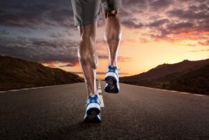exercise calorie burn 300x201 - Close up of athlete's legs running on the empty road at the sunset