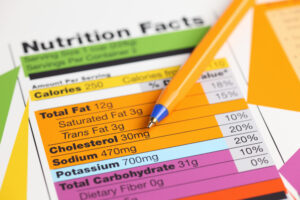 nutrition facts 300x200 - Nutrition facts and ballpoint pen. Close-up.